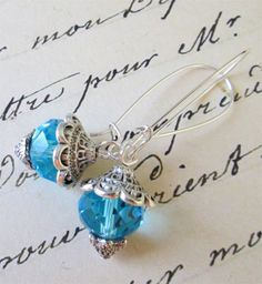 $8.00.  Pretty!  Teal and Pewter Earrings http://www.etsy.com/listing/125042612/teal-and-pewter-earrings?ref=shop_home_feat