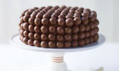The other day my daughter and I were messing around with some M&M's and we stuck them all over a cake. It looked very cool, but was not really very 'me'. So we both racked our brains and came up with Maltesers as a worthy substitute.