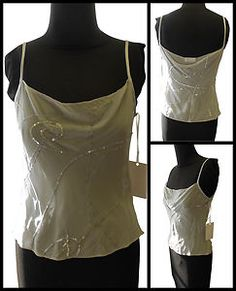 1 thin silk cami could be worn w/ strapless bra to make a sheer top (modest). & it's really beautiful. (eBay Hot Sales  *******  Price: £25 (Buy on eBay) English Eccentrics Hand embroidered/beaded,  cami cream, 100% Silk Bias cut with spaghetti straps.    -  Size 8    - Made in London)