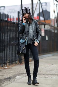 A fur trapper hat is the must-have accessory for cold fashion week days, as seen on Ruby Aldridge. Mr. Newton  - HarpersBAZAAR.com
