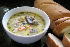 Homemade Creamy Chicken and Mushroom Soup: Chicken and mushroom soup with a loaf of bread.