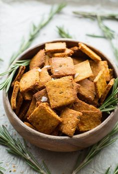 Complete your next snack board with these  Sweet Potato Paleo Crackers - only 7 ingredients needed & easy to make! |Grain Free + Vegan | bowl of crackers from 45° angle