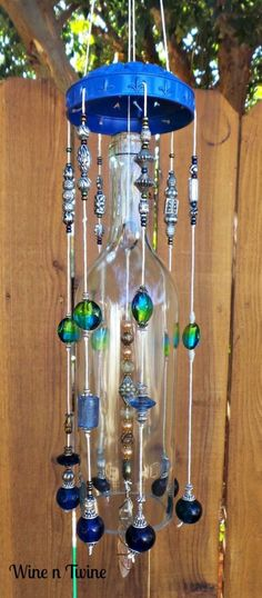 A personal favorite from my Etsy shop(Bottle Green Wind Chimes) Wine Bottle Corks, Wine Bottle Crafts, Wine Bottle Windchimes, Bottle Cut, Blue Bottle, Bottle Trees, Diy Wind Chimes, Altered Bottles, Bottles And Jars