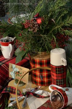Vintage red plaid Skotch Jug as a vase for assorted greenery, red berries and a cardinal ornament. | Home is Where the Boat Is #Christmas #picnic