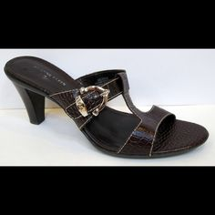 """AK Anne Klein 'Zeek"""" Brown Leather Slide Sandal These are in really great, clean condition.  Versatile sandal featuring AK iflex technology Leather upper crocodile embossed design with contrast stitch detailing Silver-tone hardware with monogram detail Leather lining Lightly padded footbed Flexible man-made sole Stacked heel 3"""" Anne Klein Shoes"""