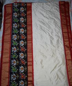 Pochampally white with black color ikkath silk saree available