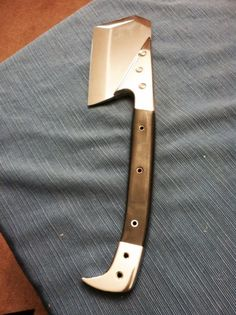 REDEMPTION. This knife was designed by Zombie Fighter Jango(Cedric Nye), and built by George Icard at GI Custom Knives. It is the ultimate Zompoc Weapon. There is no blade design that can equal this design for pure all-purpose utility. It is fierce and fast in combat, a killer.  Note the pry-bar pommel, it adds counter-balance for speed and ease of maneuvering, as well as being a useful implement for breaching.