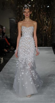 Strapless gown with floral appliques | Mira Zwillinger Spring 2017 | https://www.theknot.com/content/mira-zwillinger-wedding-dresses-bridal-fashion-week-spring-2017