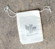 These cotton muslin drawstring bags are an easy way to wrap wedding favors.  Stamp them with your own design and you can fill them with pretty much anything!