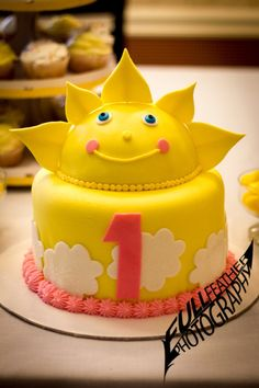 "This gorgeous sunshine cake was made for my daughter's 1st birthday party. The theme was ""You Are My Sunshine."" Like our work? Please ""like"" our page to receive the latest updates & offers."