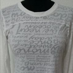 Lululemon white long sleeved top with thumbholes Lululemon long sleeved top with thumbholes. White. Never worn never washed. Size 12. I'm an 8 but prefer the looser and longer fit. lululemon athletica Tops Tees - Long Sleeve