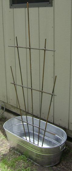 Galvanized steel wash tub planter with welded steel trellis. Ideal for any climbing fruit, vegetable, flower or vine. Available at www.lakeindustrial.net.