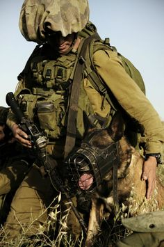 A soldier from IDF Oketz Unit with his MWD.