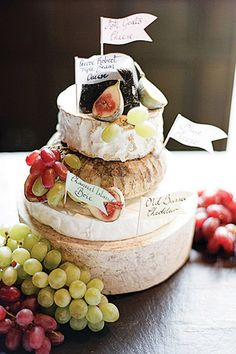 """How about a groom's cake that tickles those savory taste buds? A cheese wheel cake is a great option for foodie grooms. Work with your local deli or cheesemonger to select cheese wheels in a variety of colors, textures and flavors, and stack them together. Yum!""—Elizabeth Muhmood Kane, creator of Bridal Musings"