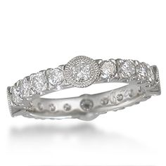 Diamond Castle Wedding Band - This diamond eternity wedding band is named for its medieval castle-like form. Instead of stone masonry, this castle is fortified by your favorite precious metal and diamonds! The bezel-set diamonds are embellished with millegraining, and the ones in-between are fishtail-set.