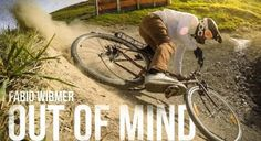 Downhill Mountain Biker Rides A Rusty City Bike Down A Mountain