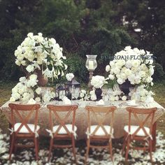 "Pinning for overall look of urn and white florals, not for specific flowers -- ""We created this stunning table on a private estate in Palm Beach for a clients wedding. We used white hydrangeas, peonies, oriental lilies, calla lilies along with a cascading garland of greens entwined with all white florals and twisted around lanterns, candle holders and urns.  #palmbeachwedding #whiteweddings #Jmorganflowers #maggiestolzberg"""