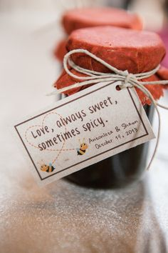 """Wedding favor?  """"hot honey"""" (honey infused with hot peppers) in rustic jars."""