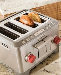 Featuring durable stainless steel and die-cast construction, the high-performance Wolf Gourmet Four Slice Toaster browns the thickest slices of artisan bread to perfection. Patent-pending self-centering bread guides deliver perfectly even results, regardless of bread type.