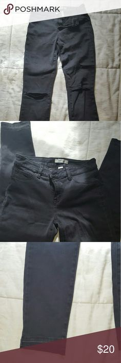 Distressed black stretch jeans Black jeans, stretch material with cut knees - both knees have slits. Unfinished hem. Worn once or twice. Selling because I tend to grab other jeans first. Black is a light black, not a deep black - hard to explain, ask if your not sure!!! 70% cotton 28% polyester 2% spandex refuge Jeans