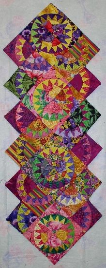 Beautiful interpretation!  Tutti Fruity New York Beauty posted by Kessi on allmyquilts