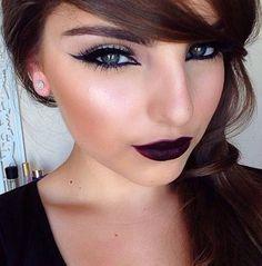 Girl with  black eyeliner & dark red lipstick