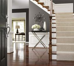 Alex Hayden - entrances/foyers - wainscoting, foyer wainscoting, charcoal gray walls, tray table, stair runner, cream stair runner, staircase waisncoting,