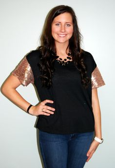 Get ready for the holidays in this top that can be dressed up or down! This black tee is very soft, and we love the sequin detailing on the arms.  Holiday Sparkle, and only $28.95!