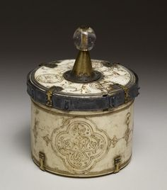 Pyx with Arabesques in Quatrofoil Frames - early 13th century (Medieval). Ivory. Palermo, Italy (?) (Place of Origin)