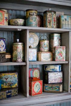 great way to display lovely old tins ...