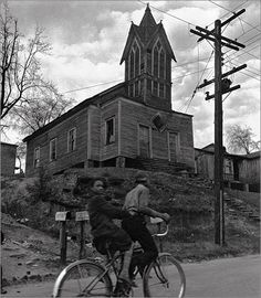 BICYCLING BY THE OLD VILLAGE CHURCH GEORGIA, 1937 John Gutmann Photography Fellowship