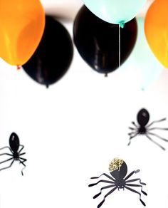 Your Halloween party needs some DIY hanging spider Balloons.