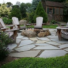 my patio idea with left over broken cement that I'm having taken out and in the center a fire pit