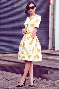 this dress would be perfect. Pockets are great for tissues at weddings