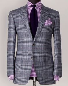 """""""Mixing patterns is a little tricky.  The rule of thumb is to vary the scale of the pattern. Wearing a window pane wool suit?  Wear a small-plaid shirt."""