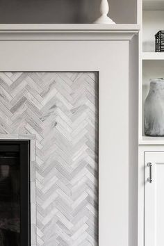 Marble Herringbone Tiled Fireplace Surround