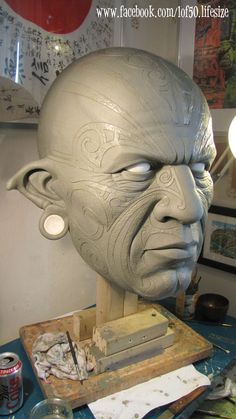 giant tribal head chavant clay medium sculpture.