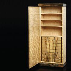 flame on:  http://www.davidbarronfurniture.co.uk/david_barron_furniture.htm