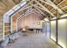 Architecture, Beautiful Modern Boathouse Design With Wooden Wall And Glass Windows And Ventilation On The Ceiling Along With Wooden Interior Decoration And Unique Fireplace Above Wooden Floor ~ Private House Designs in a Vigorous and Sturdy Wooden Structure