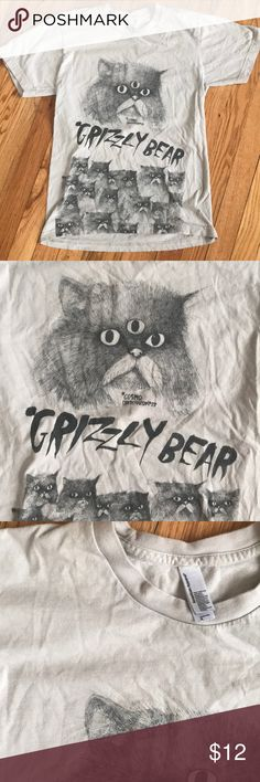 Kitty graphic tee 😸 American Apparel, printed Cat graphic tee! I really don't know.. if this is a band? Or just cool Cat stuff! I got it from one of my fav vintage/thrift stores in Brooklyn called Monk.   I don't wear it enough! American Apparel Tops Tees - Short Sleeve
