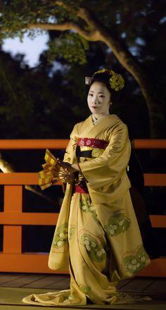 Maiko performing Kamishichiken dance.  Kyoto, Japan