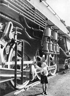 Little boy and big steam locomotive. Scary size