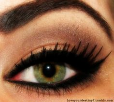 eyes exquisite green eyes with beautifully groomed (STRONG) brow and fierce kajal eyeliner & fake lashes.