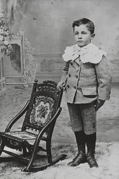 The Little Lord Fauntleroy Suit. The boy wearing tight knickerbockers with a side sash and white lace collar.