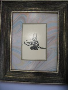 Frame with Tuğra caligraphy on Marbling Silk Texture.