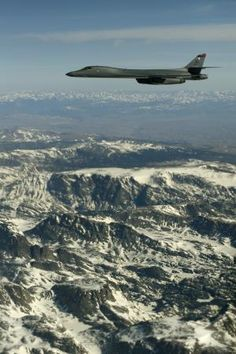 A B-1 Lancer bomber from the 34th Bomber Squadron, Ellsworth Air Force Base, S.D., flies off the wing of a 151st Air Refueling Wing KC-135 during contact training, April 10, in western Wyoming. The 151st ARW routinely supports air operations across the western United States.  2nd Combat Camera Squadron  Photo by Master Sgt. Benjamin Bloker