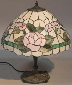 Auction House: Golding Young & Mawer Date: Wednesday 12 February 2014 A reproduction Tiffany style table lamp