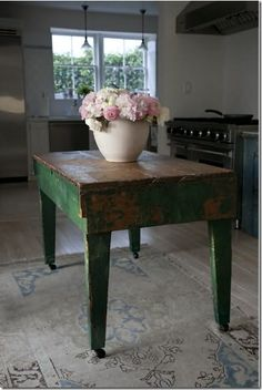 Old table as a Kitchen island.