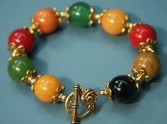 A lovely rainbow of vintage Bakelite beads. #bracelet #1940s #vintage #jewelry #accessories #Bakelite