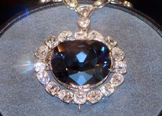 The 'Hope Diamond' - carats g), is a Fancy Dark Grayish-Blue diamond and supposedly cursed. Almost certainly cut from the French Blue Diamond. Part of the Smithsonian Collection. Shiva, Most Expensive Jewelry, Hope Diamond, Sell Silver, Mommy Jewelry, Statue, Colored Diamonds, Jewelry Stores, Diamond Jewelry